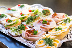Sandwiches with cold cuts at a buffet. Sandwiches on tray at a buffet with cold meat, eggs and cheese Royalty Free Stock Image