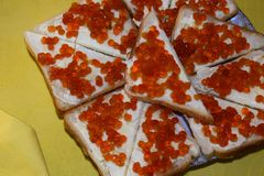 Sandwiches consist of bread, oil, red caviar. Sandwiches are located on a plate stock images