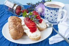 Sandwiches with cottage chees  and strawberry,. Cup of cocoa on a blue background,tasty and healthy food,vegetarian and dietetic food Royalty Free Stock Images