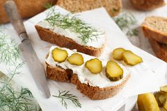 Sandwiches with cream cheese, dill and salted cucumber. On a wooden table Royalty Free Stock Photography