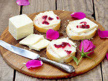 Sandwiches with cream cheese and jam of tea roses Royalty Free Stock Images
