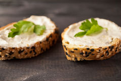 Sandwiches with creamcheese. Sandwich with cream cheese and parsley on rustic wooden background. Selective focus stock images