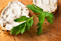 Sandwiches with creamcheese. Sandwich with cream cheese and parsley on rustic wooden cutting board. Close up royalty free stock image