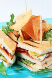 Sandwiches and crisps. Tasty appetizer - Club sandwiches and crisps royalty free stock photography