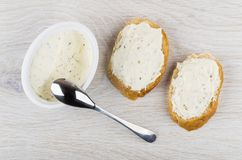 Sandwiches with curd cheese with greens, curd cheese in box. Spoon on wooden table. Top view Royalty Free Stock Photo