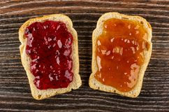 Sandwiches with currant jam, apricot jam on table. Top view. Sandwiches with currant jam, apricot jam on dark wooden table. Top view stock image