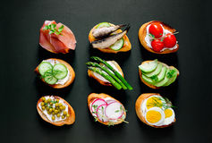 Sandwiches on a dark background Royalty Free Stock Images