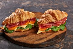 Sandwiches on a wooden light and dark background royalty free stock photo