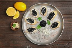 Sandwiches with delicious black caviar stock photography