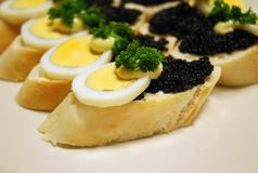 Sandwiches with egg and caviar Stock Photo