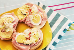 Sandwiches with egg, cheese, cucumber, ham and cherry tomatoes. Royalty Free Stock Photography
