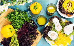 Sandwiches with eggs and red lettuce and drinks on blue table Stock Photos