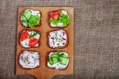 Sandwiches with feta cheese and cucumber, tomato and radish. Top Stock Photos