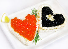 SANDWICHES WITH FISH CAVIAR. Sandwiches with red and black fish caviar on white Royalty Free Stock Photography