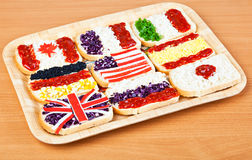 Sandwiches with flags of countries. Sandwiches with flags of different countries Stock Photos