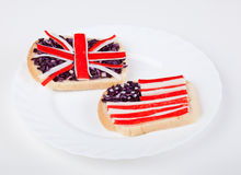 Sandwiches with flags of two countries. On plate Stock Photo