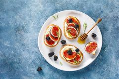 Sandwiches with fresh figs and honey. Royalty Free Stock Photography