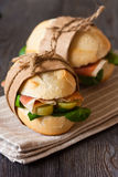 Sandwiches. Fresh sandwiches with ham and vegetables. Rustic style Royalty Free Stock Photography