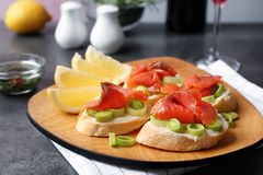 Sandwiches with fresh sliced salmon fillet on plate. Closeup royalty free stock photo