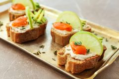 Sandwiches with fresh sliced salmon fillet. And avocado on tray royalty free stock photography