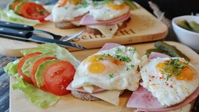 Sandwiches with fried eggs Stock Images