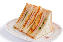 Sandwiches in front of a platter of various fillings stock image