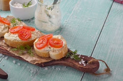 Sandwiches with goat cheese, cherry tomatoes and dil Stock Images