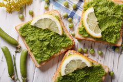 Sandwiches with green peas close up. horizontal top view Stock Photo