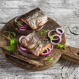 Sandwiches with grilled fish and quick pickled onions. On rustic wooden board Stock Photography