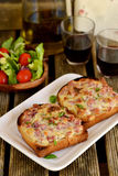 Sandwiches with ham and cheese for lunch. Open sandwiches for lunch with red wine stock images