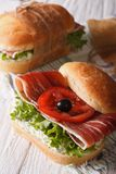 Sandwiches with ham, cream cheese and vegetables vertical Stock Photo