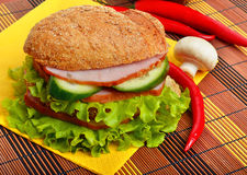 Sandwiches with  ham with cucumber and green lettuce on a napkin Royalty Free Stock Images