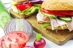 Sandwiches with ham and vegetables. On the cutting board Royalty Free Stock Photography
