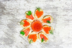 Sandwiches with heart shaped red caviar an salmon with herbs Royalty Free Stock Image