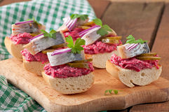 Sandwiches with herring. Beetroot and pickled cucumber stock image