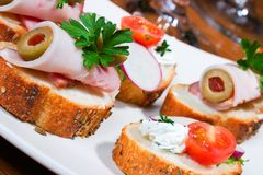 Sandwiches on holiday table Stock Images