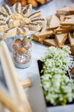 Sandwiches on holiday table. Several types of sandwiches on a table decorated with flowers stock image