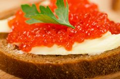 Sandwiches with imitation red caviar and butter Stock Image