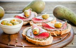 Sandwiches with italian salami and pears Stock Photo