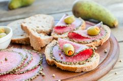 Sandwiches with italian salami and pears Stock Images