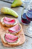 Sandwiches with italian salami and wine Royalty Free Stock Images