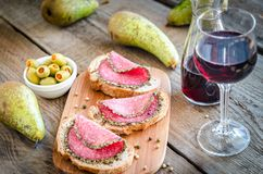 Sandwiches with italian salami and wine Stock Photography