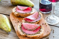 Sandwiches with italian salami and wine Stock Photos