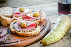 Sandwiches with italian salami and wine Stock Image