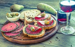 Sandwiches with italian salami and wine Stock Images