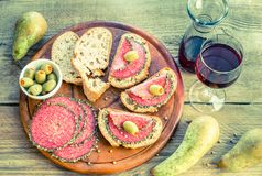 Sandwiches with italian salami and wine Royalty Free Stock Photo