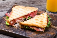 Sandwiches with jamon, lettuce and toasted bread royalty free stock photos