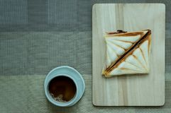 Sandwiches like on a wooden tray. stock images