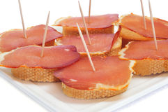 Sandwiches with lomo embuchado, spanish cured pork sirloin Stock Photography