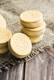 Sandwiches made from cookies and ice cream with condensed milk on a table with burlap Royalty Free Stock Photography